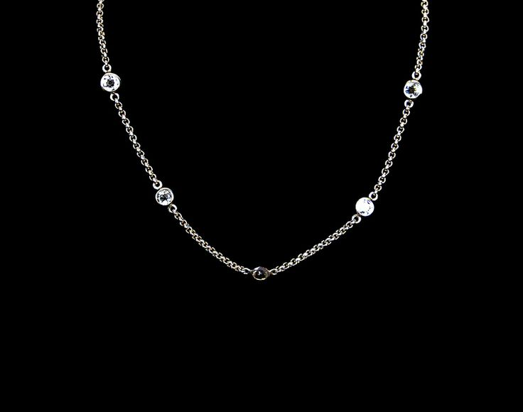 "Drops of Karma Necklace - 92.5% silver - 14"" slim silver link chain - Delicately lined with 1.65cts white topaz pendants - Lobster fastening"