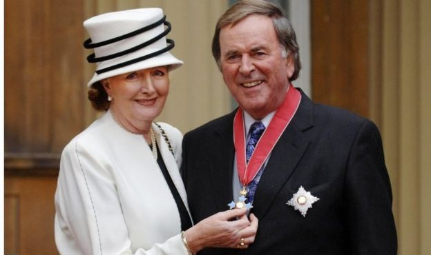 Sir Terry Wogan with his wife Lady Helen after collecting his knighthood from Queen Elizabeth II in 2005