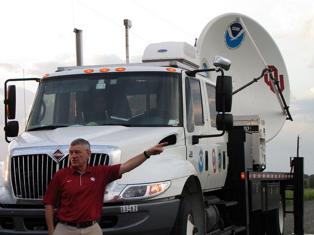 """NSSL retired scientist Don Burgess pioneered the concept of """"nowcasting"""" by using radar to direct an NSSL research team during a tornado intercept and lead the discovery of the """"tornado vortex signature"""" seen in radar displays. Burgess leads the NO-XP mobile radar team. Nebraska, Omaha. 2009 May 31.  Photographer: Susan Cobb, NOAA/OAR/NSSL.  Credit: VORTEX II"""