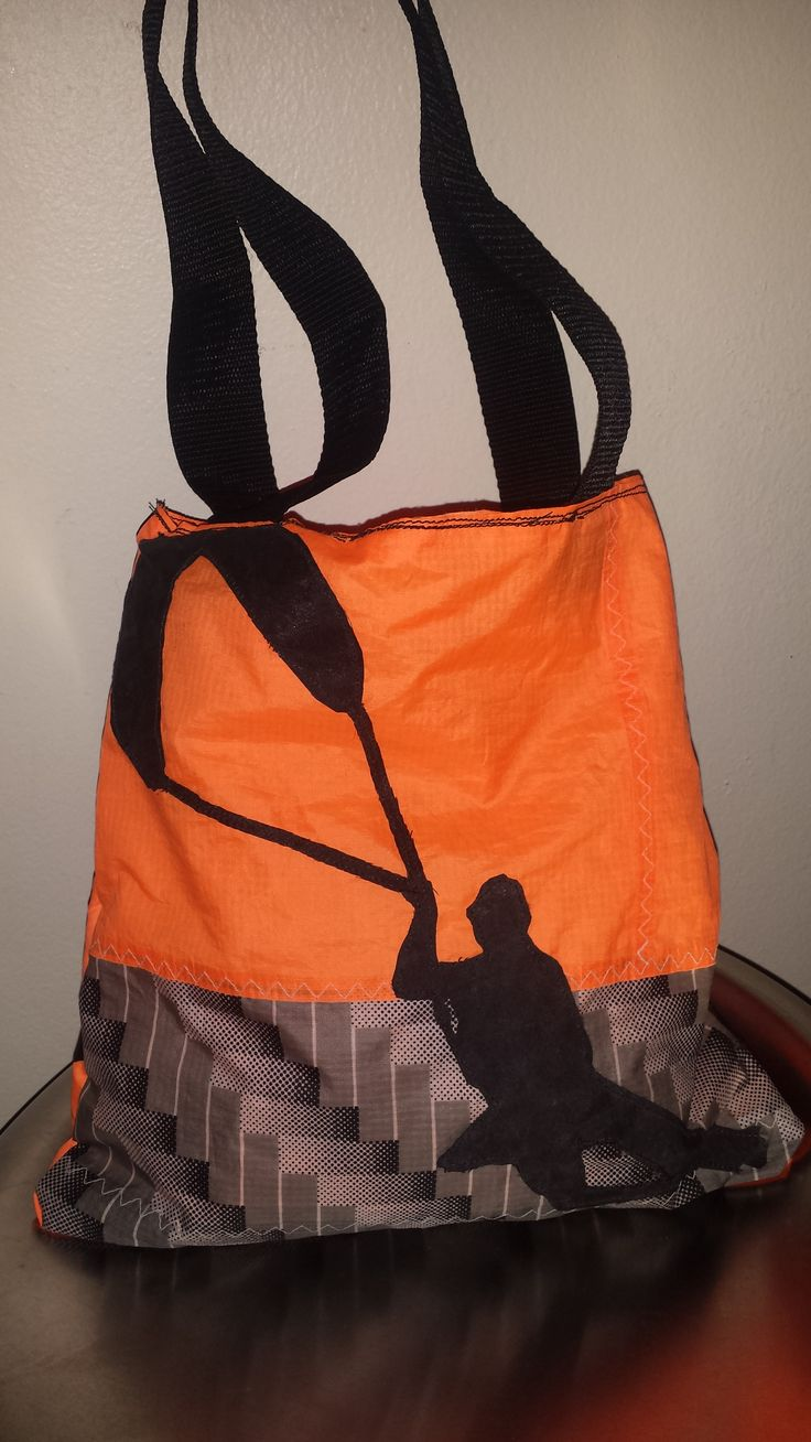 Handmade with a picture of a kite surfer on the bag