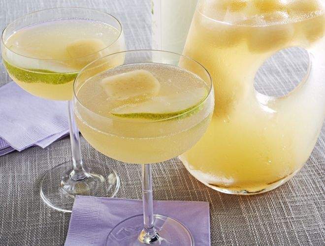 This lightly sweet and sophisticated champagne punch recipe is perfect to bring to a party. Just add the bubbly when you arrive and it's ready to go!