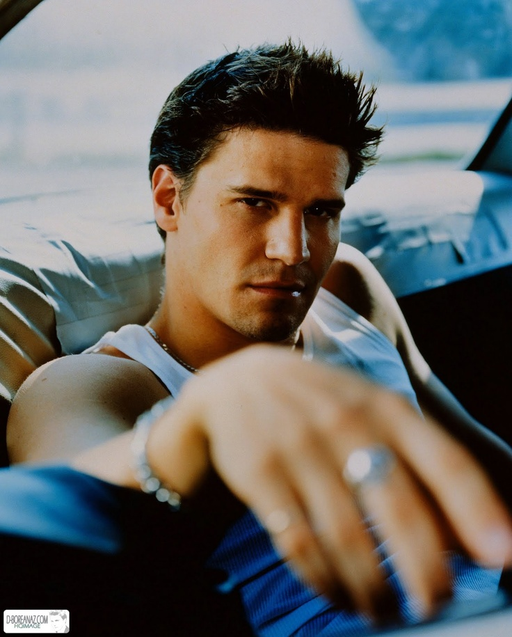 David Boreanaz...if I die I hope he's waiting in heaven for me...only a 23year age difference... Im totally okay with that for him!!! *drools* im his Buffy the Vampire Slayer days!