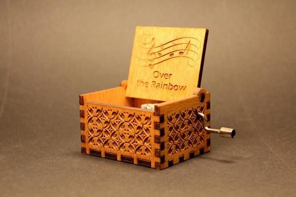"Engraved Wooden Music BoxMaterial: 4mm birch plywood  Size:  WxHxD: 65x55x40mm (2.55""x2.16""x1.57"") Finish: Natural oak stainTune: Over The Rainbow       Welcome to the wonderful world of crankshaft music boxes!  Original hand crank Music Box, just turn the handle and it will play this well-known tune.Try on wood or glass or different surfaces for a new sound.  This music box makes a great gift for any music lover.The design is inspired by vintage storage boxes with track name engrav..."