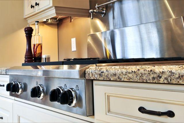 New Venetian Gold Granite Countertops w/ cream cabinets & black pulls