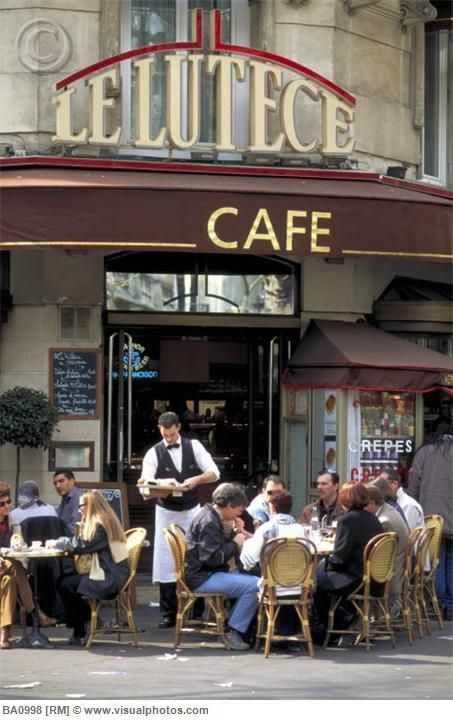 French sidewalk cafe (Le Lutece is a cafe found on Saint Michel Boulevard in the Latin Quarter. Sidewalk cafes are popular in France for people-watching and romantic dates. Paris, France.)  Photo by  David R. Frazier  / PR Science