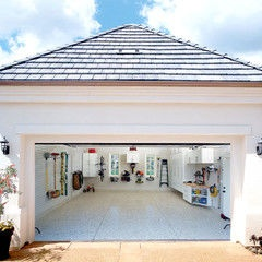 Traditional garage and shed by Garage Envy