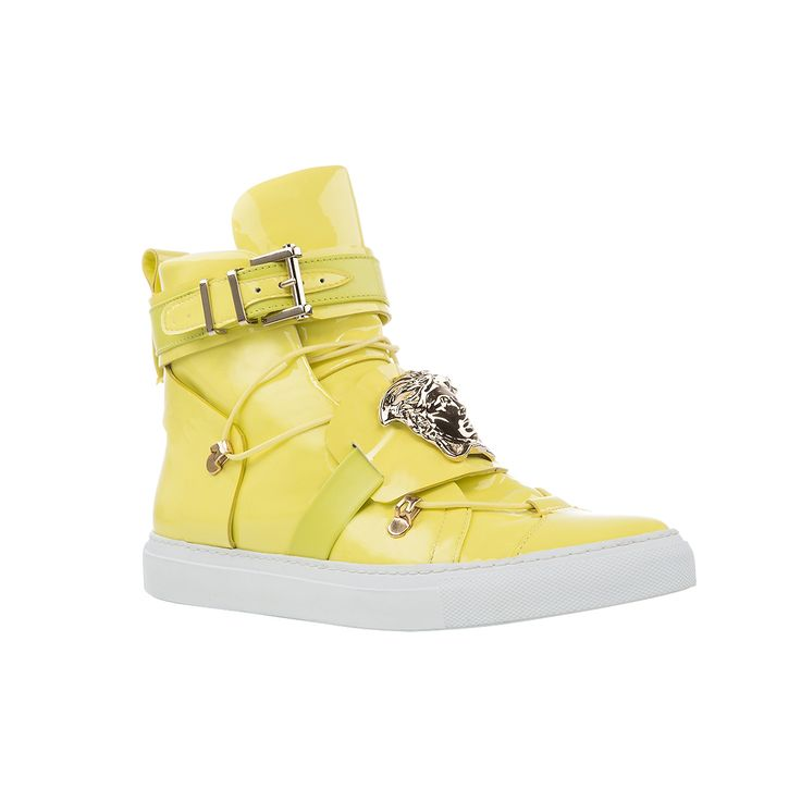 Get the perfect off-duty attitude wearing these Palazzo high-top sneakers in bright yellow. Find more #Versace sneakers inspirations on versace.com  #VersaceSneakers