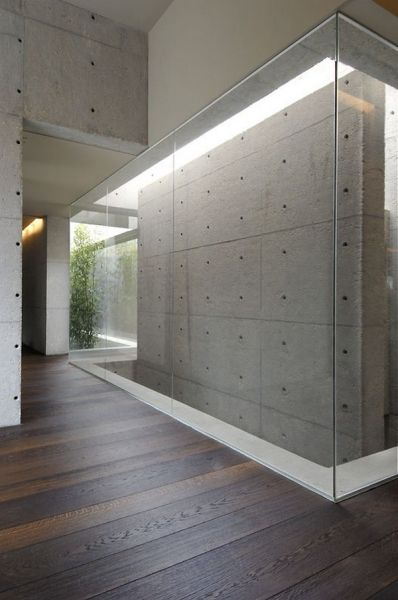 Concrete House by A-cero reinforces my love for textured grey, lighting and the life-force of wooden floors