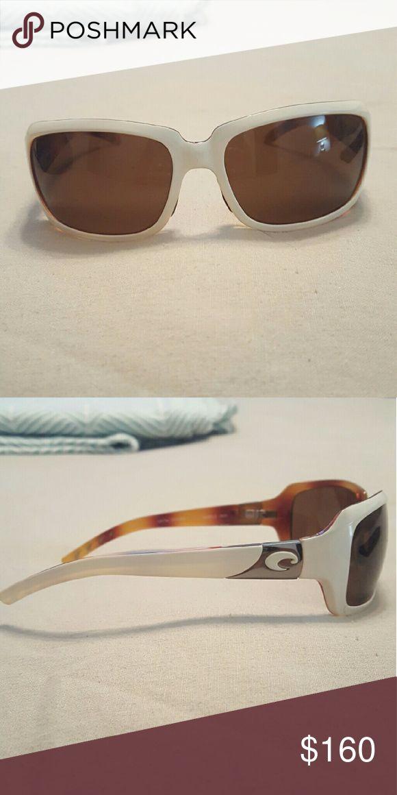 Costa Del Mar womens sunglasses White Costa Del Mar sunglasses with tortoise color on the inside. The lenses are polarized lenses. Brand new still. Costa Del Mar Accessories Sunglasses