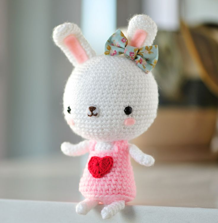 "Free crochet pattern for ""Sweetheart Bunny"" with a fabric bow and rosy cheeks!"