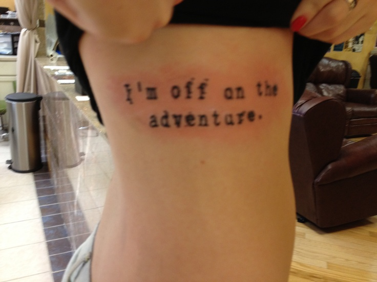 Mr. Rager Kid Cudi tattoo it has a lot of meaning to me. Basically live your life; it's all a big adventure.