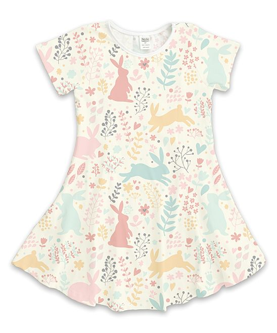 Bunnies adorn this comfy shift dress. A cream, blue, yellow and pink color combo is a sweet option for little ones. 100% polyesterMachine wash; tumble dryImported