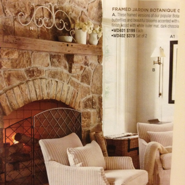love this stone fireplace with a wood beam mantle