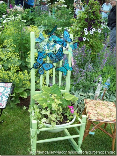 Rocking Chair Planter - Blue butterflies just jump right out from the pale  green chair, really they are there because of the container plants!