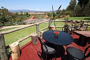 Ngorongoro Farm House: Deck overlooking the farm -- http://adventureswithinreach.com/tanzania/safari/lodging.php?map=Ngorongoro