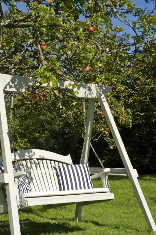 I like the idea of a swing on a frame under a tree instead of attached to the tree. With Oliva engraved
