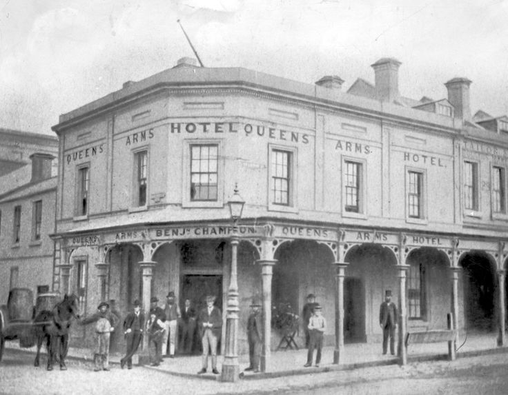 Photograph of the Queens Arms Hotel, Swanston Street Melbourne, ca.1880. Shows hotel on corner with a number of men standing under verandah, and a horse pulling two barrels on a cart.