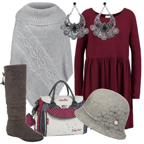 Un cappellino con ricami floreali e una borsa con pois si abbinano ad un semplice vestito in maglina, da indossare con gli stivali alti al ginocchio e con una mantella in calda lana. Un paio di orecchini a pendente in cristallo donano un tocco di luce.
