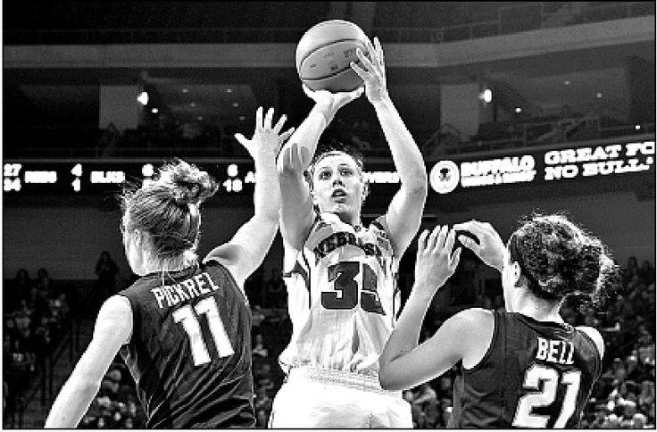 San Antonio Star Kayla McBride dishes the ball across the key.