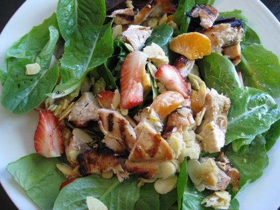 Orange Strawberry Salad  with Orange Dressing.  ~~~  This Salad is awesome, and you'll be licking your plate for every drop of the dressing!  It's THAT good!