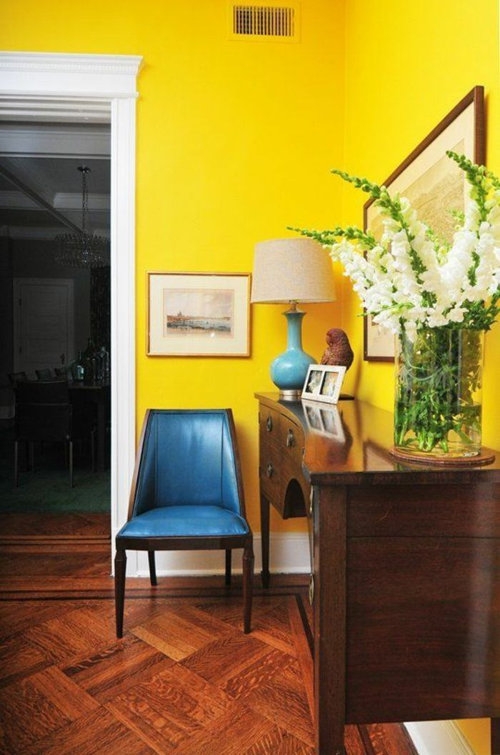 Living Room Paint Colors, Bright Yellow Wall With White Door Frame,  Saturated Blue Chair And Blue And Cream Lamp, Brown Wooden Chest Of  Drawers, ... Part 97