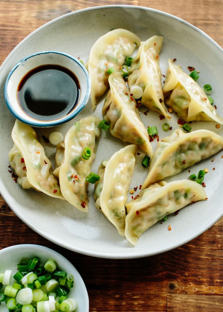 If you think frozen pork dumplings from the store are addictive, then just you wait until you try these homemade fellas. They are everything you want in a dumpling: plump and nicely chewy, filled with tender pork, flavored with fresh ginger, green onion, and sesame oil. Bet you can't eat just one. Whether you're celebrating the Lunar New Year with friends this week or stocking your freezer for a busy month ahead, these dumplings should definitely be on your list. Here's a step-by-step recipe…