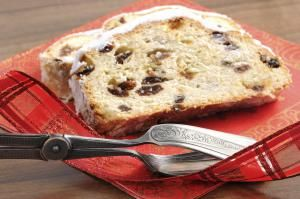 Christstollen on red napkin with star and cake tong - hsvrs/E+/Getty Images