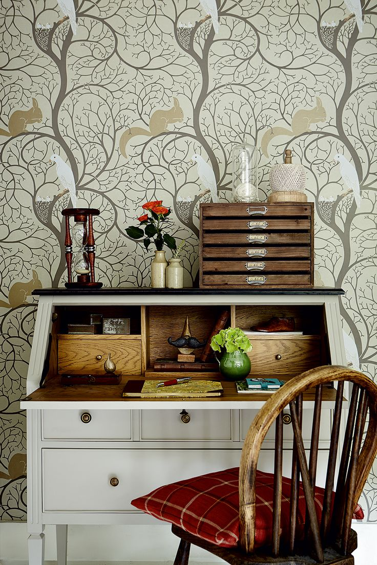 Neutral bureau stands out against a statement patterned wallpaper