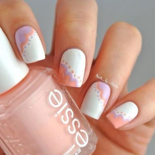 Geef je basic witte nagellak een verrassende touch met een pastelkleurige nailartpen. (via Flair.be - http://www.flair.be/nl/beauty/279200/14-allerleukste-pastelnagels-van-pinterest)
