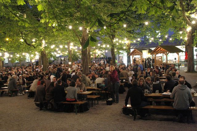 Munich Beer Garden. I don't drink but I still think it would be fun to visit one of the many beer gardens and enjoy some good food, music, and company.