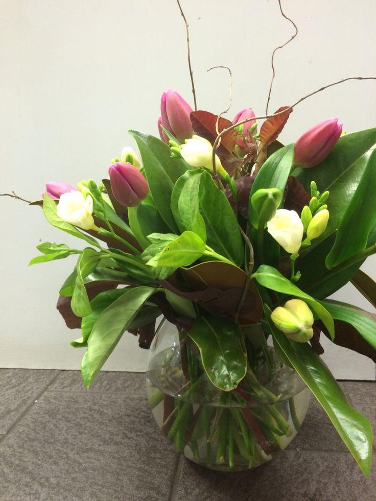 Ball vase with pink tulips, white freesia