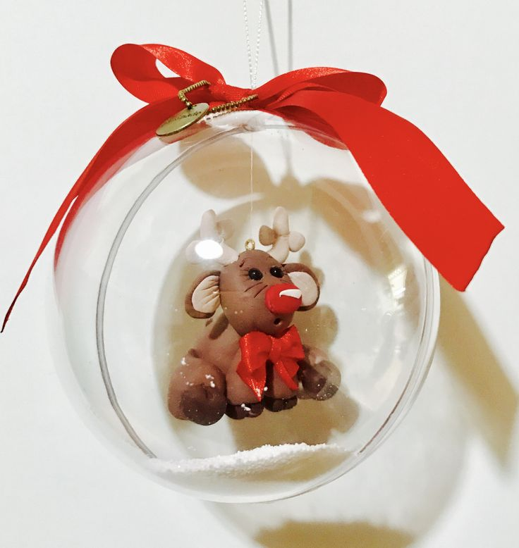 Christmas ornament: polymer clay reindeer in a polyester clear ball.