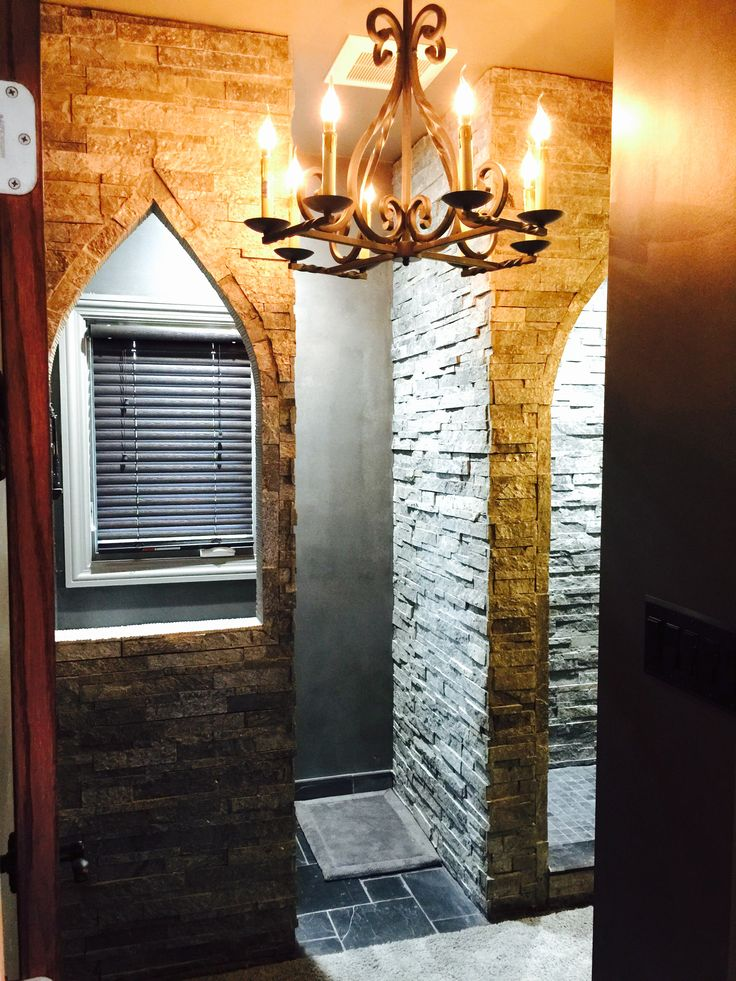entrance to our first floor guest bathroom with old world castle theme with arched cut - Slate Castle Ideas