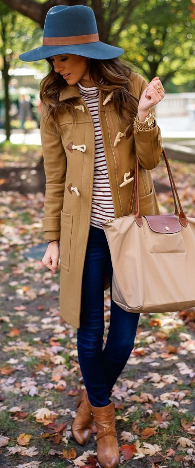 Marry a camel duffel coat with dark blue skinny jeans and you'll look like a total babe. Brown leather booties will bring a classic aesthetic to the ensemble.   Shop this look on Lookastic: https://lookastic.com/women/looks/duffle-coat-turtleneck-skinny-jeans/22353   — Blue Wool Hat  — White Horizontal Striped Turtleneck  — Gold Watch  — Gold Ring  — Gold Bracelet  — Camel Duffle Coat  — Tan Nylon Tote Bag  — Navy Skinny Jeans  — Brown Leather Ankle Boots