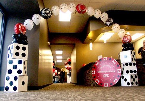 balloon archway, cardboard dice, and giant cardboard chip