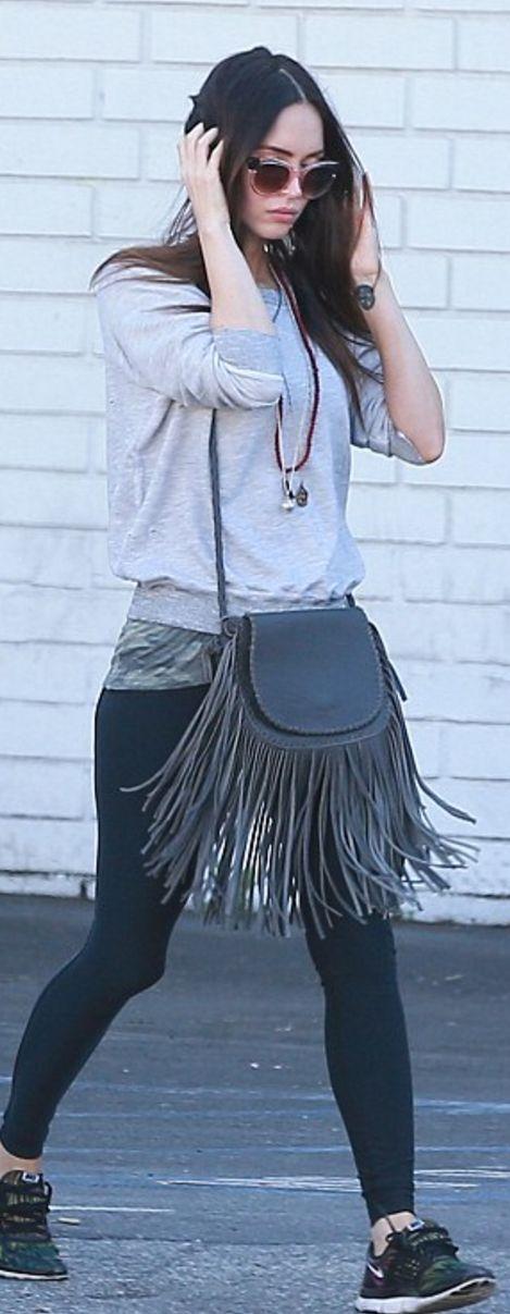 Who made  Megan Fox's black sneakers, green print tee, and gray fringe handbag?