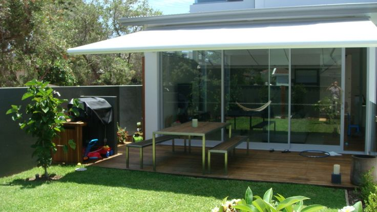 Post project decking and bbq area. The bbq is screened from view from the side pathway by extending the wall
