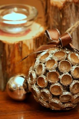 """Acorn Cap Ornament    Here is what you will need:  Acorn caps  Burnt Umber craft paint (and brush)  3"""" Styrofoam ball  Jute twine  Small piece of floral wire (18 gauge)  Narrow ribbon  Silver glitter (or your choice of color)  Mod Podge  Hot glue gun"""