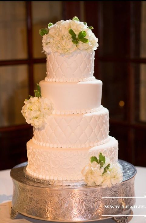 White 4 tier wedding cake with white hydrangea and magnolia leaves annacakes.com   Wedding cakes ...