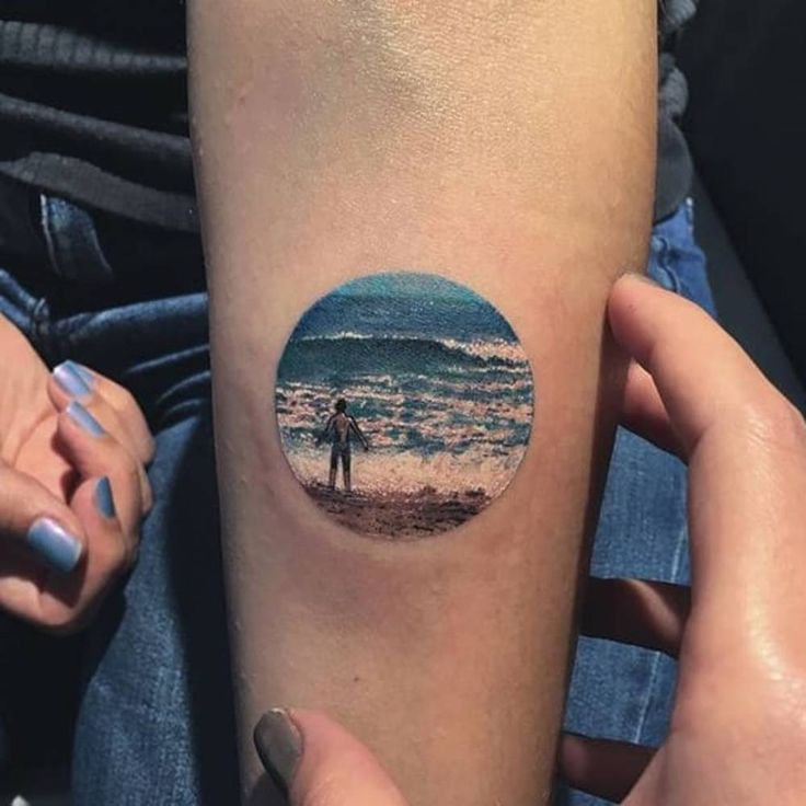 Beach landscape tattoo on the inner forearm.
