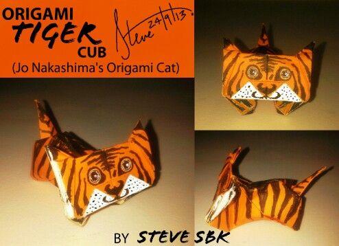 Jo Nakashima's origami cat. I turned it into a baby cub.