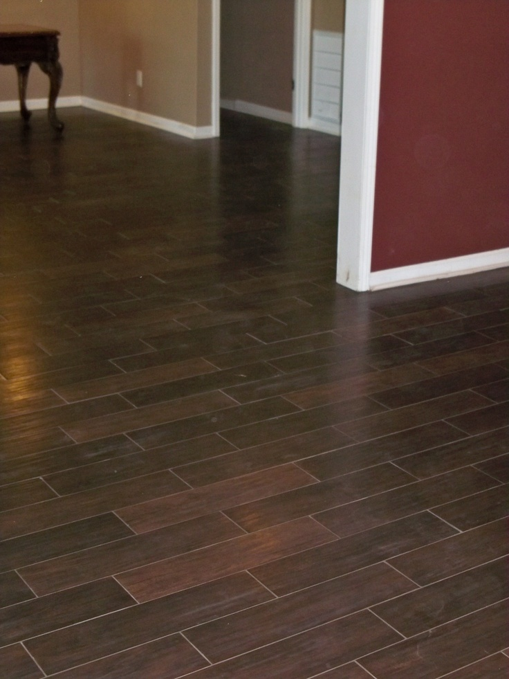 Wood look tile installed in a basement in n forsyth co for Wooden floor tiles