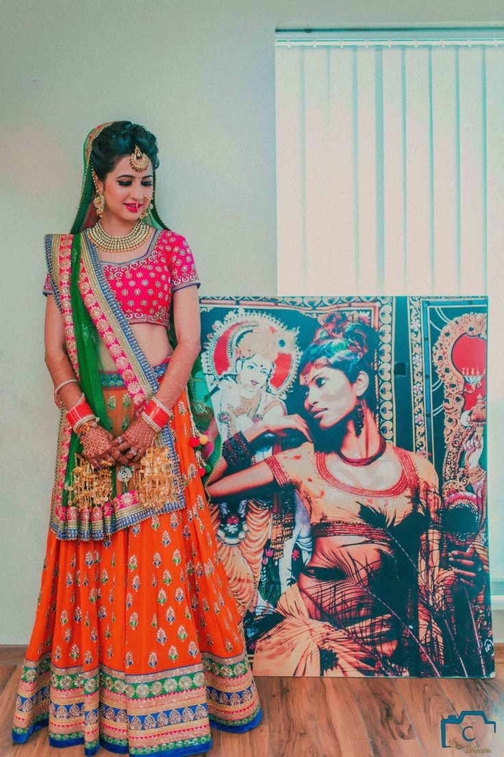 Bridal Lehengas - Red and Orange Lehenga   WedMeGood   Red and Gold Blouse, Orange and Gold Lehenga with Gold and Blue Border, Parrot Green Net Dupatta with Red and Blue Border  #wedmegood #red #bridal #lehengas