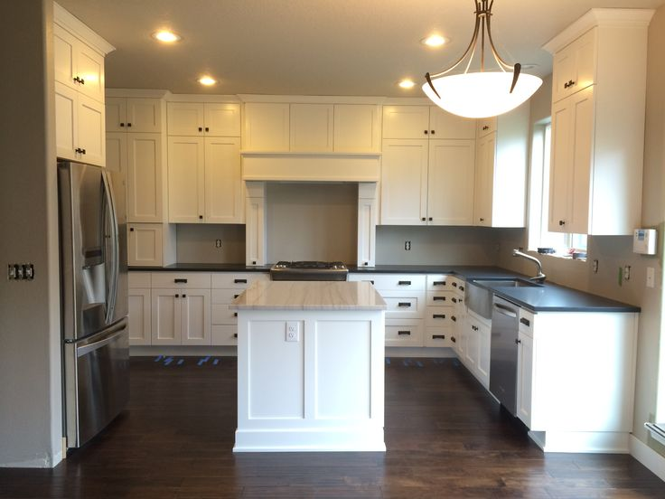 Kitchen remodel white shaker cabinets absolute black for Kitchen design zurich