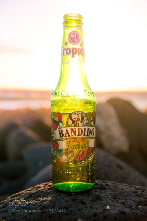 Tequila Sunset by sdwilt from http://500px.com/photo/217228415 - Tequila beer on the beach watching the surfers. More on dokonow.com.