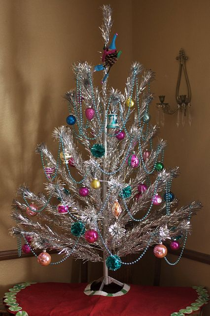 Vintage aluminum Christmas tree in all of its finery!