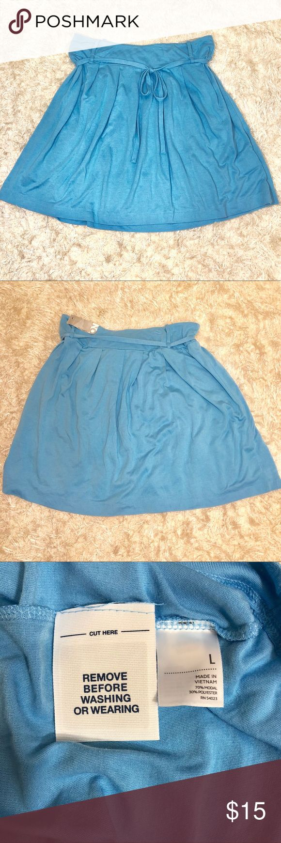 """Blue Jersey Mini Skirt Old Navy Size Large Light Blue Jersey mini skirt Old Navy size large New with tags Pleated and tie belt  Waist stretches from 16"""" across lying flat to 21"""" length 21 inches Old Navy Skirts Mini"""