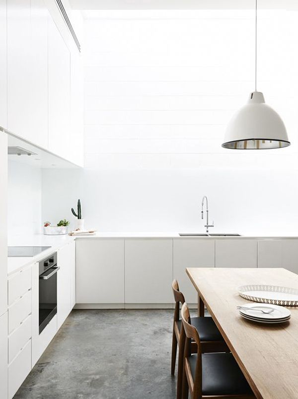 white kitchen concrete floor
