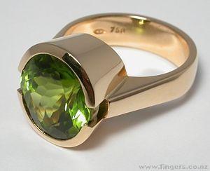 Contemporary New Zealand Jewellery by Kobi Bosshard.   Ring,  18ct gold and Peridot
