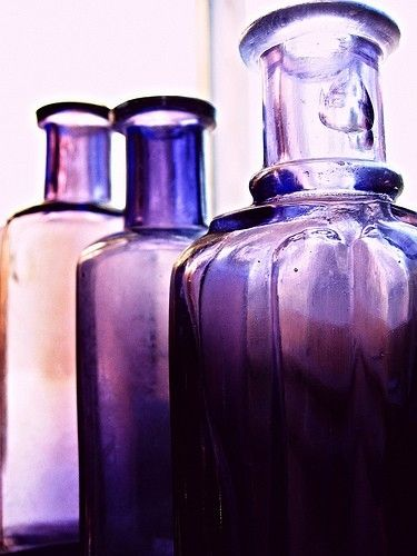 Purple Glass Bottles. by katharine